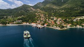 Aerial Beautiful View From Above To Kotor Bay And Regular Passenger Ferry From Lepetane To Kamenari By A Sunny Afternoon Stock Image