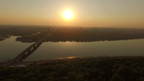 Aerial - Beautiful view of sunset over Dnipro river in the Kyiv. The action in the real time stock footage