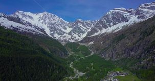 Aerial of big mountain in the Italian alps pull in stock video footage