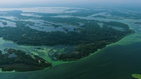 Aerial of big river with small islands polluted with blue green algae. Environmental problems, ecology and nature stock footage