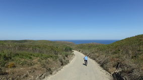 Aerial from biker biking to the beach stock video
