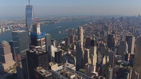 An aerial bird eye perspective on NYC New York City, famous modern Manhattan skyscrapers and towers on a river stock footage