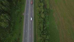 Aerial bird eye top view of road in countryside, Russia stock footage