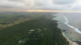 Aerial bird eye view of coast with sand beach and palm trees and water of Indian Ocean, Mauritius Island. Aerial bird eye view of coast with sand beach and huge stock video
