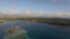 Aerial bird eye view of coast with sand beach and transparent water of Indian Ocean, Mauriticus Island stock video