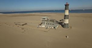 Aerial bird eye view of old lighthouse in Namibia stock video footage