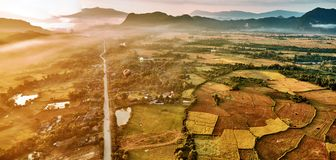 Aerial view of a hot air baloon over rice fields in rocky mounta Stock Photography