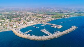 Aerial Zygi, Larnaca. Aerial bird`s eye view of Zygi fishing village port, Larnaca, Cyprus. The fish boats moored in the harbour with docked yachts and skyline royalty free stock photos