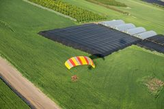 The aerial or bird view on motorized paraglider flying. Close to the ground stock images