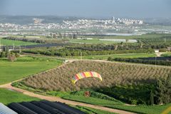 The aerial or bird view on motorized paraglider flying. Close to the ground royalty free stock photos