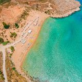 Aerial birds eye view drone photo Agia Agathi beach near Feraklos castle on Rhodes island, Dodecanese, Greece. Panorama with sand stock image