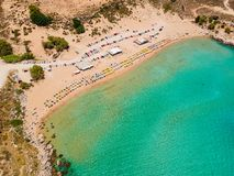 Aerial birds eye view drone photo Agia Agathi beach near Feraklos castle on Rhodes island, Dodecanese, Greece. Panorama with sand. Beach and clear blue water royalty free stock photography