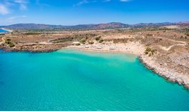 Aerial birds eye view drone photo Agia Agathi beach near Feraklos castle on Rhodes island, Dodecanese, Greece. Panorama with sand. Beach and clear blue water stock image