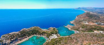 Aerial birds eye view drone photo Anthony Quinn and Ladiko bay on Rhodes island, Dodecanese, Greece. Panorama with nice lagoon and. Aerial birds eye view drone stock photo