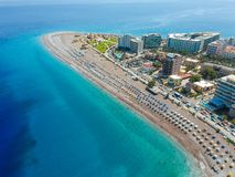Aerial birds eye view drone photo of Elli beach on Rhodes city island, Dodecanese, Greece. Panorama with nice sand, lagoon and. Clear blue water. Famous tourist royalty free stock photography