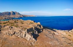 Aerial birds eye view drone photo Feraklos castle near Agia Agathi beach on Rhodes island, Dodecanese, Greece. Panorama with sand. And clear blue water. Famous royalty free stock photography