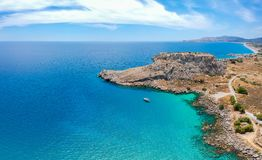 Aerial birds eye view drone photo Feraklos castle near Agia Agathi beach on Rhodes island, Dodecanese, Greece. Panorama with sand. And clear blue water. Famous royalty free stock images