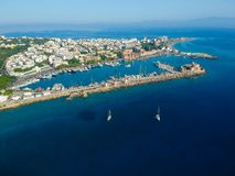 Aerial birds eye view drone photo of Rhodes city island, Dodecanese, Greece. Panorama with Mandraki port, lagoon and clear blue. Water. Famous tourist royalty free stock photography