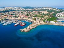 Aerial birds eye view drone photo of Rhodes city island, Dodecanese, Greece. Panorama with Mandraki port, lagoon and clear blue. Water. Famous tourist stock images