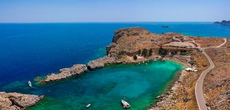 Aerial birds eye view drone photo Saint Paul bay near village Lindos, Rhodes island, Dodecanese, Greece. Sunny panorama with royalty free stock images