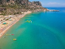 Aerial birds eye view drone photo Tsambika beach near Kolympia on Rhodes island, Dodecanese, Greece. Sunny panorama with sand. Beach and clear blue water stock image