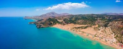 Aerial birds eye view drone photo Tsambika beach near Kolympia on Rhodes island, Dodecanese, Greece. Sunny panorama with sand royalty free stock photography