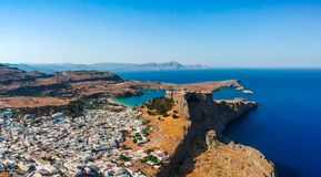 Aerial birds eye view drone photo of village Lindos, Rhodes island, Dodecanese, Greece. Sunset panorama with castle, Mediterranean stock photo