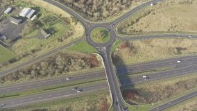 Aerial birds eye view of the M7 motorway in Ireland. Motorway with bridge, roundabouts, and movement. Aerial birds eye view of the M7 motorway in Ireland stock footage