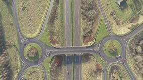 Aerial birds eye view of the M7 motorway in Ireland. Motorway with bridge, roundabouts, and movement. Aerial birds eye view of the M7 motorway in Ireland stock video footage