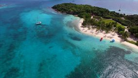 Aerial birds eye view photo taken by drone of tropical seascape and sandy beach with turquoise clear waters Royalty Free Stock Images