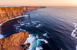 Aerial birds eye view from the world famous cliffs of moher in county clare ireland. beautiful irish scenic landscape. Aerial birds eye view from the world Royalty Free Stock Photos