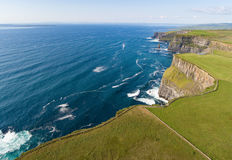 Aerial birds eye view from the world famous cliffs of moher in county clare ireland. beautiful irish scenic landscape. Aerial birds eye view from the world Stock Photo