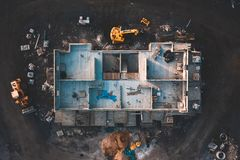 Aerial birdseye image of a house being built. Aerial birds eye image of the frame of a house being built on a construction site at sunset - Wooden floor and stock photo