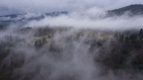 AERIAL: A blanket of fog covers the landscape stock video footage