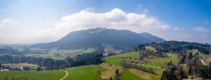 Aerial blomberg mountain. european alps bavaria spring. Green gras fields royalty free stock photography