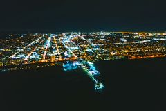 Aerial blurred view of the Santa Monica shoreline at night. Aerial defocused view of the Santa Monica shoreline, amusment park and pier at night Royalty Free Stock Photos
