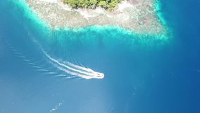 Aerial of Boat and Coral Reef in Raja Ampat stock video