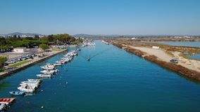 Aerial. The boat is sailing to sea on the Ria Formosa. Fusetta Tavira. stock video