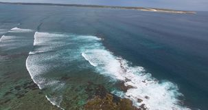 Aerial of breakers at Surf Point - Dirk Hartog Island, Shark Bay World Heritage Area. Low level aerial video of massive breaking waves at Surf Point on Dirk stock footage