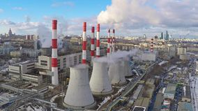 Aerial camera approaching electric power station in winter