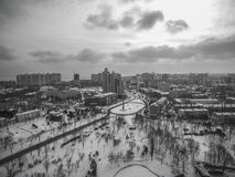 Aerial camera captures snow covered pine trees in Victory Park Odessa. The resort of Arkadia is in the background Stock Image