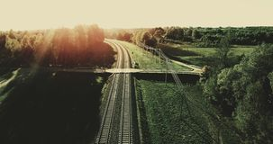 Aerial. Camera flight from train tracks to the high summer sunset sky filter added. 4k. Aerial. Camera flight from train tracks to the high summer sunset sky stock video footage
