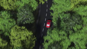 Aerial camera following red car driving on a curvy forest road. 3D rendering. Aerial camera following red car driving on a curvy forest road Stock Photo