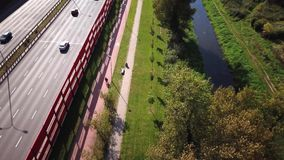 Aerial: the camera follows a bike on the highway, having fun and enjoying the road stock video footage