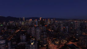 Aerial Canada Vancouver BC. Aerial video of downtown Vancouver BC at night in Canada stock video footage