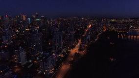 Aerial Canada Vancouver BC. Aerial video of downtown Vancouver BC at night in Canada stock footage