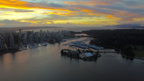 Aerial Canada Vancouver BC. Aerial video of downtown Vancouver BC in Canada at sunset stock footage