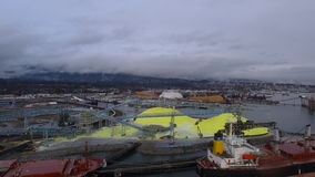 Aerial Canada Vancouver BC. Aerial video of a freighter and industrial area in Vancouver BC, Canada stock video