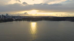 Aerial Canada Vancouver BC. Aerial video of a freighter and industrial area in Vancouver BC, Canada stock footage