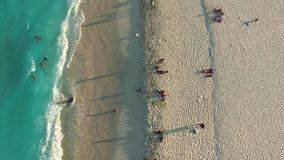 Aerial of Cancun beach. Dronetot view of shore line, people, ocean waves stock footage